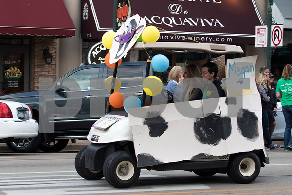 Sam Buckner for Shaw Media.<br /> The FFA car disguised as a cow, drives down State st. on Wednesday October 4, 2017.