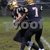 Hiawatha quarterback Tyler Kilcullen (7) hands off to Kyle Thompson in first half action against Walther Christian on Friday in Kirkland.  Steve Bittinger - For Shaw Media