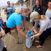 Jonathan Tressler — The News-Herald <br> A scene from the Headlands Beach Clean-Up project undertaken by volunteers from Lakeland Community College in conjunction with Alliance for the Great Lakes' Adopt-a-Beach program - part of Lakeland's yearlong 50 Acts of Service campaign to commemorate the school's 50th anniversary.