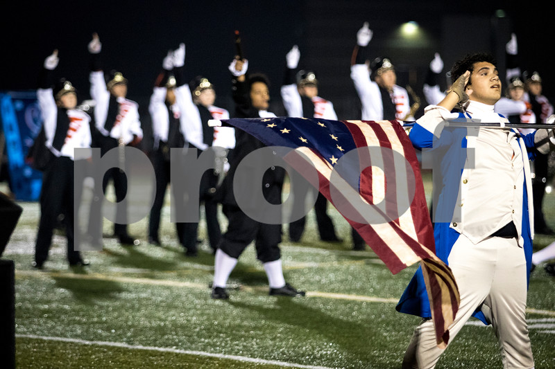 "Sam Buckner for Shaw Media.<br /> The DeKalb Marching Band at the end of their halftime performance featuring songs from ""Hamilton"" on Friday October 15, 2017."
