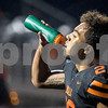 Sam Buckner for Shaw Media.<br /> Jaylen Hobson gets a drink in the first quarter against Ottowa on Friday October 15, 2017.