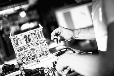 Engineer at work serviceing SR machine, Alias Hire engineering department, Hackney, London, UK