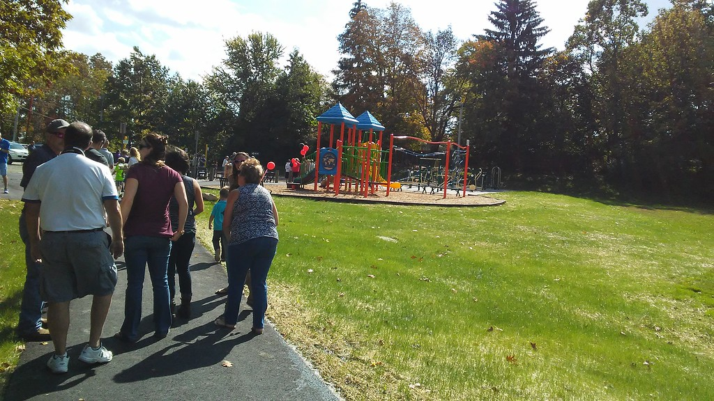 . Betsy Scott � The News-Herald <br> An asphalt path joins the newly dedicated Chardon Living Memorial Park with the parking lot at the high school. The park was dedicated Oct. 7 in honor of those who died and those who survived the shooting at the school in 2012.