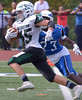 Methacton running back Mike Torcini breaks away from Norristown's Malik Smith Oct. 7, 2017. / Bob Raines--Digital First Media