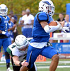 Methacton's Will Roese grabs Norristown running back John Devine Oct. 7, 2017. / Bob Raines--Digital First Media