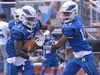 Norristown's Izaiah Webb hands off to Kirk Wilson Oct. 7, 2017. / Bob Raines--Digital First Media