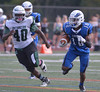 Boubacar Diawara sprints up field  pursued by Methacton's Joe Hughes Oct. 7, 2017. / Bob Raines--Digital First Media