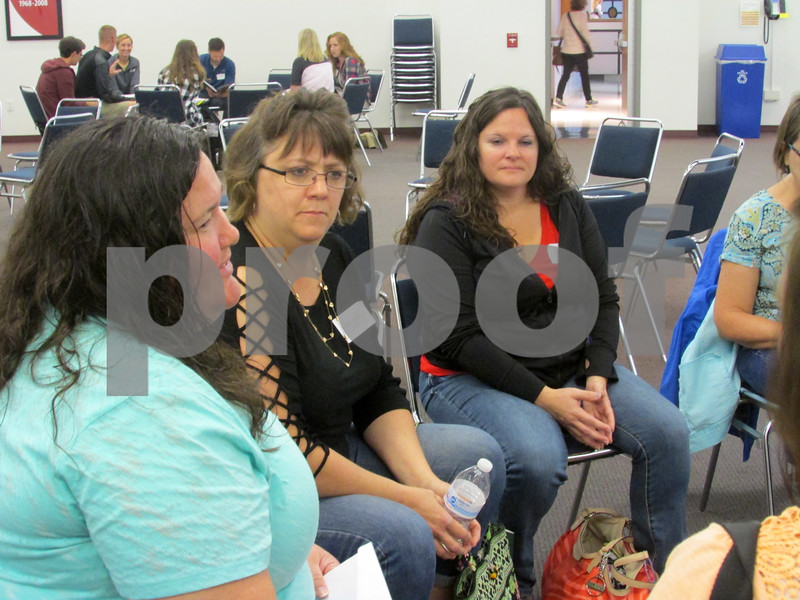 Fifth-grade teachers from DeKalb County school districts brainstorm teaching methods during the countywide institute day Friday at Kishwaukee College.