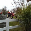 Tractors pull through a cemetery during the Huntsburg Pumpkin Fest.<br />  (Betsy Scott/The News-Herald)