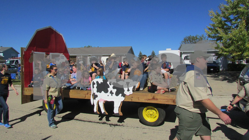 """Farming was the theme for the 36th year of the parade, and about 10 community groups decorated floats to be judged on originality and design. Several other organizations – including Boy and Girl Scouts, local marching bands and political candidates – also participated, waving to the large crowds that gathered along the parade route.<br /> <br /> After the parade ended, the community was invited to the 14th annual Cortland Festival at Cortland Community Park, where children enjoyed bounce houses, a climbing slide and food from local vendors.<br /> <br /> Judi Butler, one of the event organizers, said the festival started when two Cortland children asked the mayor to host a parade and the mayor agreed, thus beginning the popular tradition. The parade's theme is different every year, and Butler said that it was time that farming was honored.<br /> <br /> """"We like to get the community involved and out so they can meet their neighbors,"""" she said. """"Farmers are hardworking people in our community. They feed us and have been taking care of us forever. I come from a farming family, and I know how hard they work, so it's nice to show appreciation."""""""