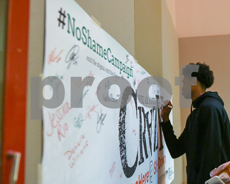 NIU freshman Justin Lee signs a banner for the #Same Here, #NoShameCampaign before the start of a talk in the Duke Ellington Ballroom October 9th.