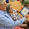 On Thursday Mayor Dean Mazzarella showed up to the Manor on the HIll inLeominster to give Alberta McWilliams a certificate for turning 100. Her son Jim  McWilliams reads her the certificate. SENTINEL & ENTERPRISE/JOHN LOVE