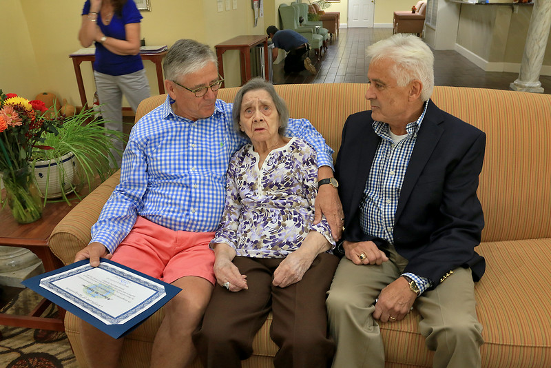 On Thursday Mayor Dean Mazzarella showed up to the Manor on the HIll inLeominster to give Alberta McWilliams a certificate for turning 100. She sits with her son's Jack and Jim McWilliams after she got her certificate. SENTINEL & ENTERPRISE/JOHN LOVE