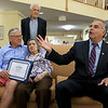 On Thursday Mayor Dean Mazzarella, on right, addresses the crowd at the Manor on the Hill in Leominster after he gave Alberta McWilliams a certificate for turning 100. With her is her two son's Jack, standing, and Jim McWilliams. SENTINEL & ENTERPRISE/JOHN LOVE