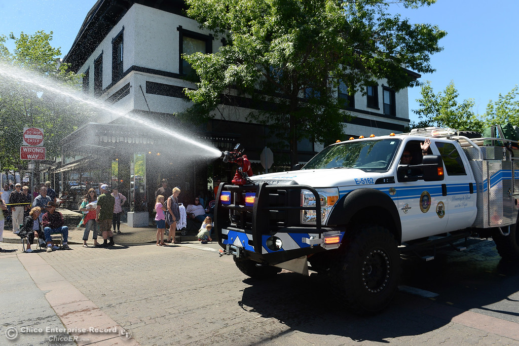 . Mooretown Rancheria firefighters in the second engine shoot water onto the engine in front Saturday, May 13, 2017, during the Feather Fiesta Days parade in downtown Oroville, California. (Dan Reidel -- Enterprise-Record)