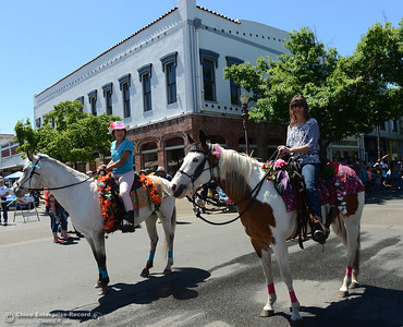 Linda Chambers, left, on Spice, and Cindy Rubeck, right, on Sapphire, as Feather Fiesta Days feature a parade, a car show, a chili cook off and more Saturday, May 13, 2017, in downtown Oroville, California. (Dan Reidel -- Enterprise-Record)