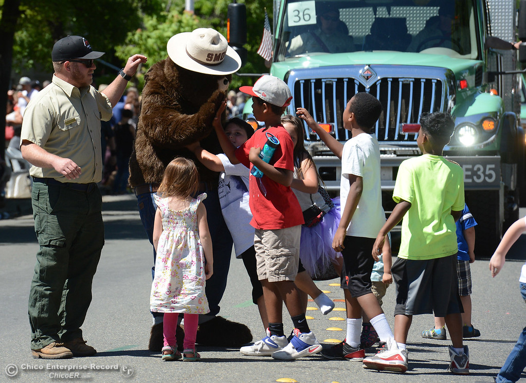 . SMokey Bear gets mobbed by youngsters as Feather Fiesta Days feature a parade, a car show, a chili cook off and more Saturday, May 13, 2017, in downtown Oroville, California. (Dan Reidel -- Enterprise-Record)