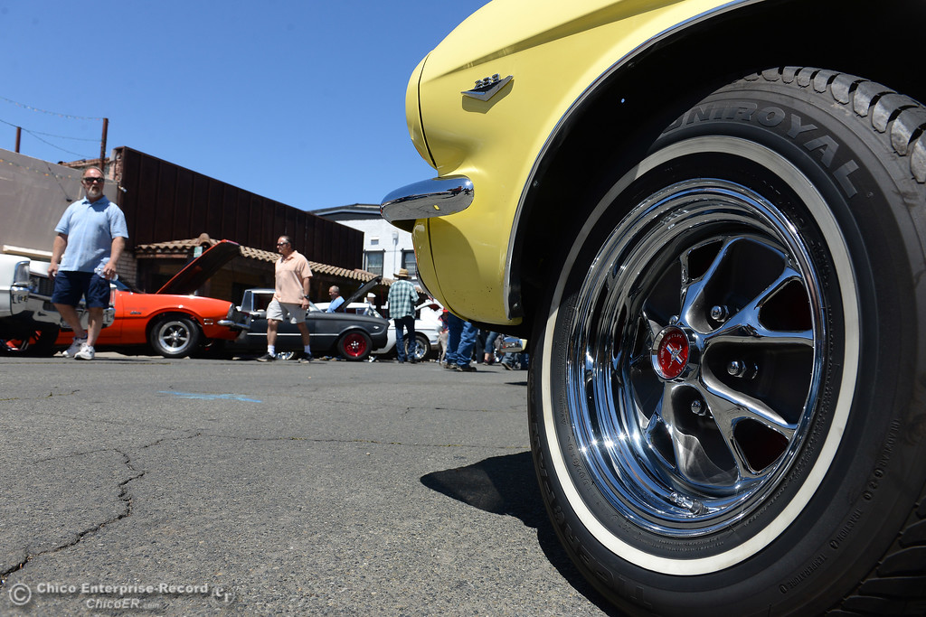 . People view cars in the Feather Fiesta Days car show Saturday, May 13, 2017, in downtown Oroville, California. (Dan Reidel -- Enterprise-Record)