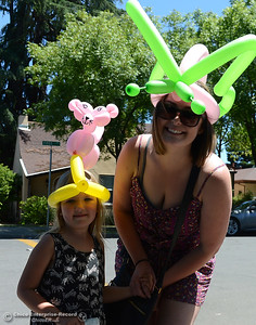 Ava Hill, 5, and Ana Briscoe, of Oroville, smile as Feather Fiesta Days feature a parade, a car show, a chili cook off and more Saturday, May 13, 2017, in downtown Oroville, California. (Dan Reidel -- Enterprise-Record)
