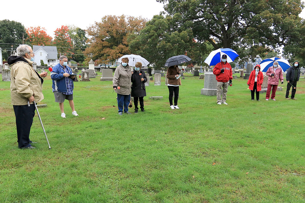 . A remembrance ceremony of the common burial site for the victims of the 1918-1919 influenza pandemic was held at the Evergreen Cemetery in Leominster on Saturday, October, 13, 2018. Leominster Historical Commission member Rocco Palmieri address everyone as they gathered around the mass grave of about 20 people that died from the pandemic. They are all wearing face masks just they would have done during the pandemic. SENTINEL & ENTERPRISE/JOHN LOVE