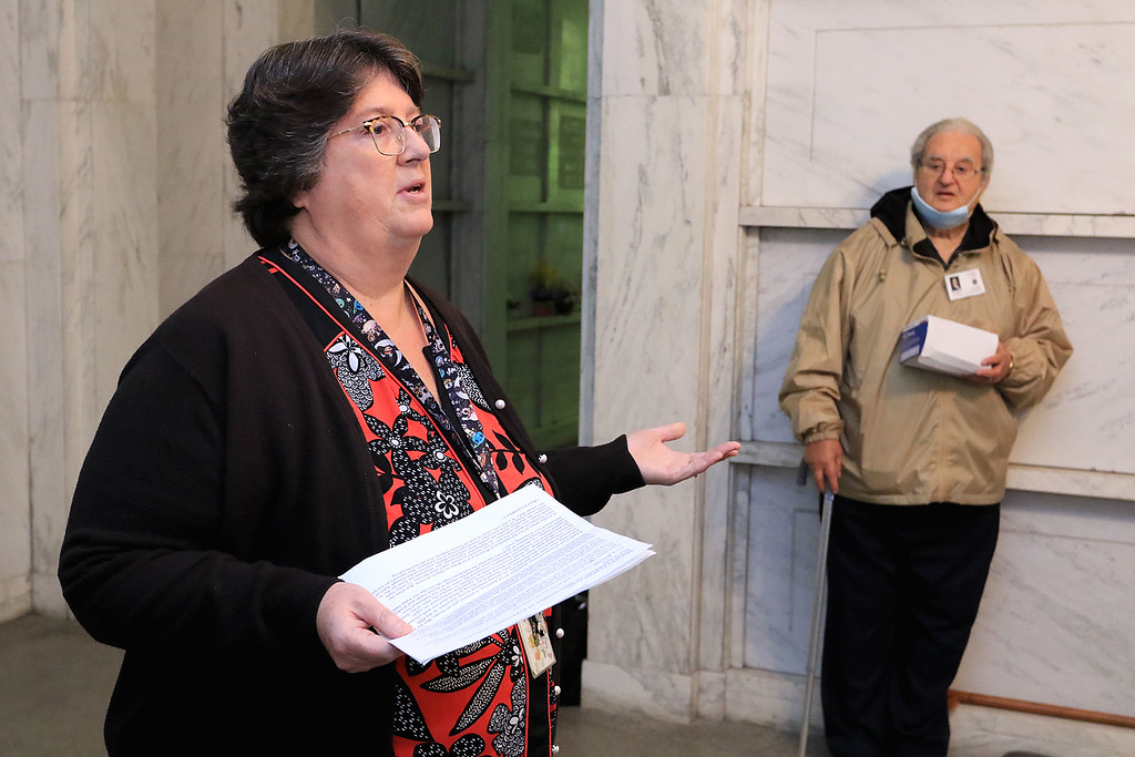 . A remembrance ceremony of the common burial site for the victims of the 1918-1919 influenza pandemic was held at the Evergreen Cemetery in Leominster on Saturday, October, 13, 2018. Diane Sanabria with the Leominster Historical Society addresses the crowd at the ceremony inside the Haws Memorial Chapel in the cemetery before they went out to see the mass grave and lay flowers. SENTINEL & ENTERPRISE/JOHN LOVE