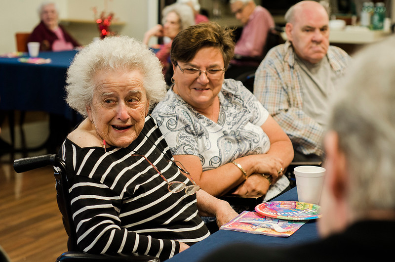 Jackie LeBlanc looks on as her mother, Doris Rosseau, born on July 25, 1917, celebrates her 100th birthday at Golden Living Centers in Fitchburg on Thursday, July 27, 2017. SENTINEL & ENTERPRISE / Ashley Green