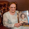 Eleanor Bissonette holds a photograph of her younger self at her 100th birthday celebration at Slate Bar and Grill on Friday, July 21, 2017. SENTINEL & ENTERPRISE / Ashley Green