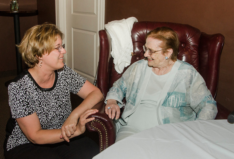 Denise Shatos, a neighbor, greets Eleanor Bissonette at her 100th birthday celebration at Slate Bar and Grill on Friday, July 21, 2017. SENTINEL & ENTERPRISE / Ashley Green