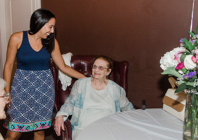 Mignon Bissonette greets her grandmother Eleanor Bissonette at her 100th birthday celebration at Slate Bar and Grill on Friday, July 21, 2017. SENTINEL & ENTERPRISE / Ashley Green