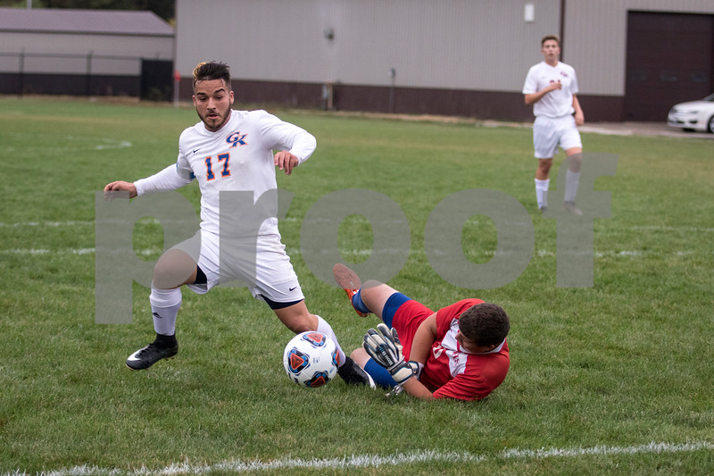 Sam Buckner for Shaw Media.<br /> Damen Tijerina tries to kick the ball out of reach of Johnsburg's goalie on Wednesday October 11, 2017 at Genoa-Kingston High School.
