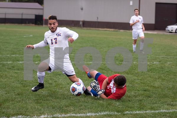 Sam Buckner for Shaw Media.<br /> Damen Tijerina tries to kick the ball out of reach of Johnsburg's goalie on Wednesday October 11, 2017 at Genoa-Kingston High School.