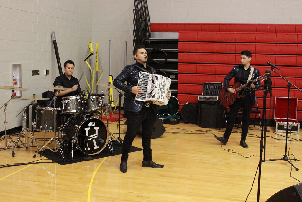 . Tawana Roberts � The News-Herald <br> Los Kbros band entertains large audience at Hispanic Heritage Night held at Harvey High School on Oct. 11.