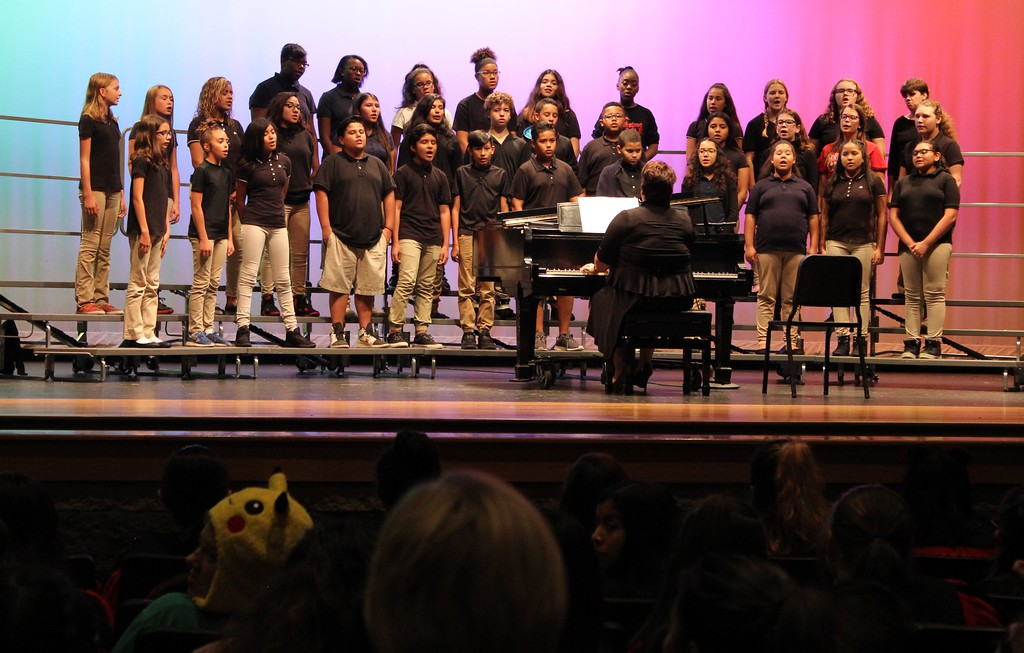 . Tawana Roberts � The News-Herald <br> 7th Grade Chorus performs at Hispanic Heritage Night on Oct. 11.