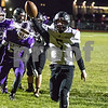 Sam Buckner for Shaw Media.<br /> Grant McConkey runs a touchdown in during the first quarter against Rochelle on Friday October 11, 2019 at Rochelle High School.