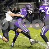 Sam Buckner for Shaw Media.<br /> Preston Ruud tackles Eric Briseno of Rochelle for a loss on Friday October 11, 2019 in Rochelle.