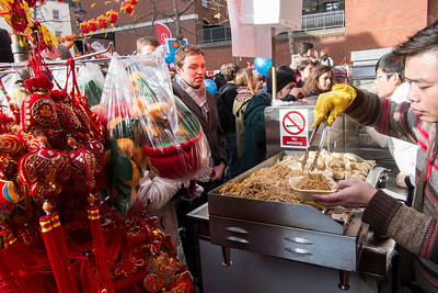 Stall selling traditional Chinase food, West End, Chinese New Year celebrations, London, United Kingdom