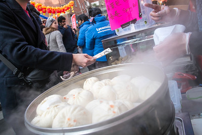 Traditional Chinese food stall selling steamed buns,  West End, Chinese New Year celebrations, London, United Kingdom
