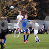 Sam Buckner for Shaw Media.<br /> Carson Riggs heads the ball during the regional semi-final game against Westminister Christian on Wednesday October 12, 2016.