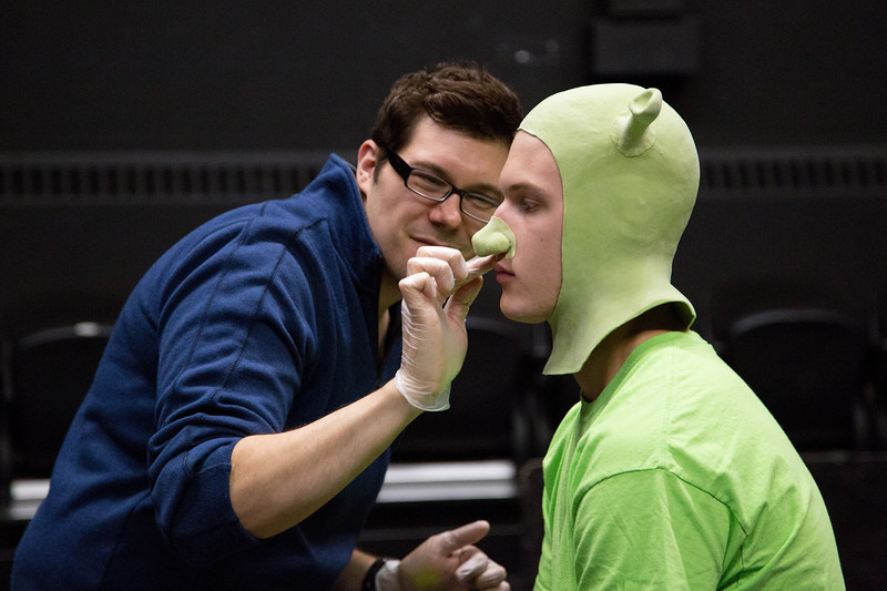 Professional makeup artist Tyler Green demonstrates to students how to apply special effects makeup, transforming Brady Grustas into Shrek.
