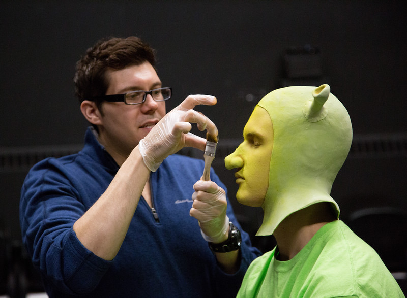 Professional makeup artist Tyler Green demonstrates to students how to apply special effects makeup, transforming