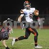 DeKalb quarterback Noah Valin avoids the tackle of Yorkville's Matt Megazzini during their game Oct. 13 at Yorkville High School.