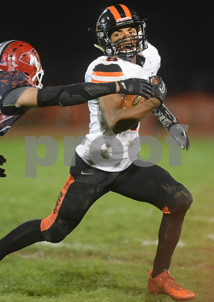 DeKalb junior Jordan Gandy avoids a tackle during their game against Yorkville Oct. 13 at Yorkville High School.