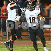 DeKalb senior Tyrese Dyson is congratulated by teammate Matthew Montavon after scoring a touchdown in the first quarter of their game against Yorkville Oct. 13 at Yorkville High School.