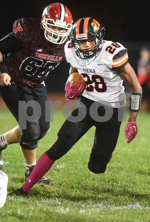 DeKalb running back Jaylen Hobson finds some room to run during the game against Yorkville Oct. 13 at Yorkville High School.