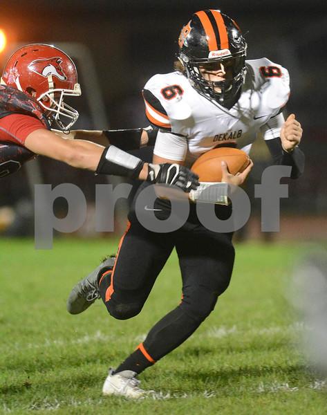 DeKalb quarterback Noah Valin scrambles for yardage during their game against Yorkville Oct. 13 at Yorkville High School.