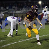 Richmond-Burton's Matthew Kortan (#8) runs the ball against Genoa-Kingston in the first quarter at Richmond-Burton High School.
