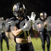 Sam Buckner for Shaw Media.<br /> Dylan Lozeau claps with his team before the game on Friday October 13, 2017 against Morris.