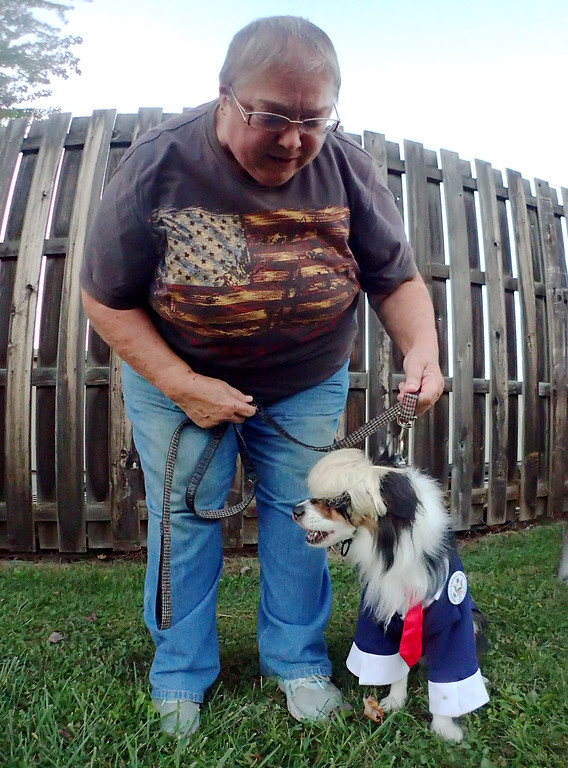. Jonathan Tressler - The News-Herald. A pup dressed up as Donald Trump primps for a portrait at Mentor�s 10th Annual Howl-O-Ween Party for Dogs Oct. 13.