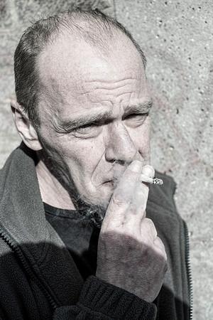 Peter Bond smoking a cigarette