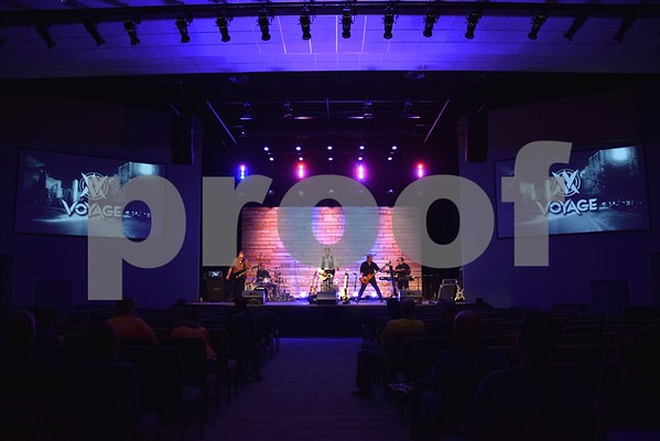 "The main congregation area of Christ Community Church, 2350 Pride Ave. in DeKalb, called ""The Auditorium,"" features moveable cushioned chairs, not church pews, a stage, lighting, sound equipment and two large screens."